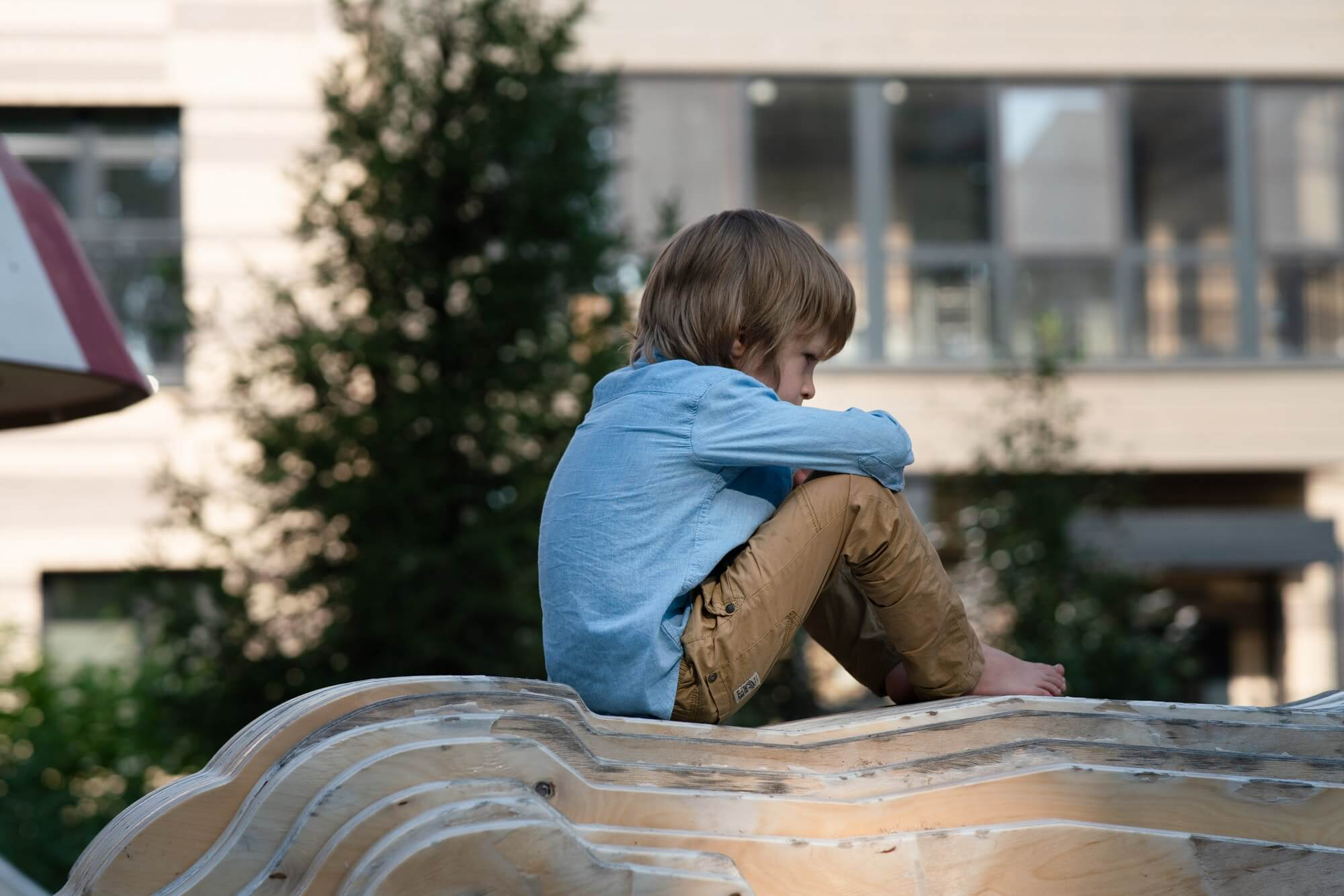 Sad angry boy on the Playground. Punished, divorce